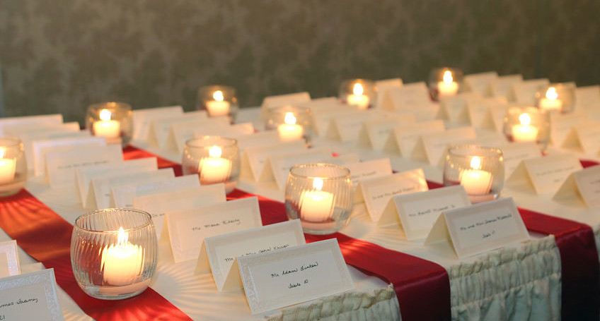 1526931 - small candles lighting placecards for guests at a wedding reception
